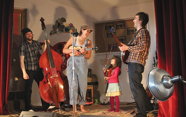 "The Lyndsey Battle Trio, joined by guest fiddler Bella, Lyndsey's daughter, play Lorde's ""Song of the Year"" hit, ""Royals,"" on May 4 at The Sanctuary, where the band opened for the Sumner Brothers. - PHOTOS BY BOB DORAN"