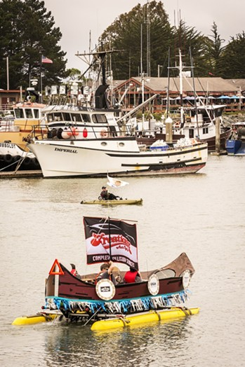 The Mariners: Team Hoosier Daddy looks like it belongs on the bay as it paddles east past the Woodley Island Marina. - MARK LARSON