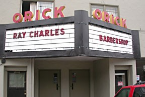 The new owner of the old Orick Theater has a sense of humor, but the barbershop's for real.