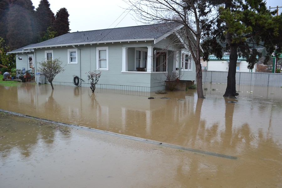 The water rises around this Fortuna home. - MELISSA SANDERSON