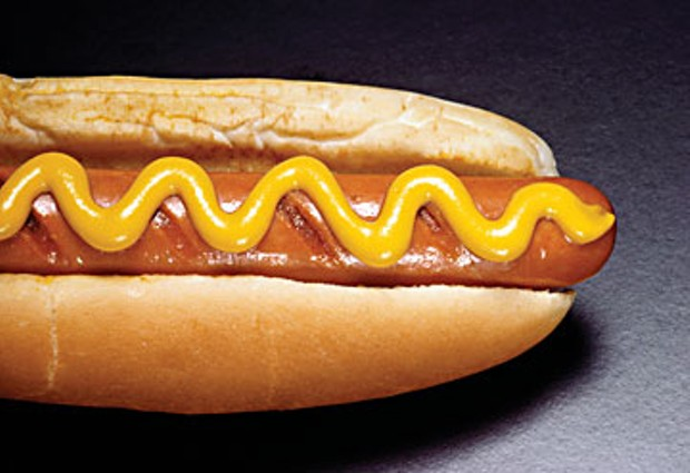 """""""...there is one way to eat a hot dog: snuggled in a hot dog bun, with a thick ribbon of spicy mustard along its full length."""""""