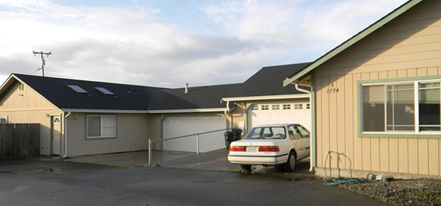These two units, joined by a garage wall, became the site of discord after the family in front complained that the occupants in back were running a marijuana grow. The opaqued garage windows on the back unit were one of the first clues, the neighbors said