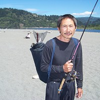 Combat Fishing on the Klamath This is the first time Siavu Chang has fished, and this is his first-ever caught fish. Photo by Heidi Walters