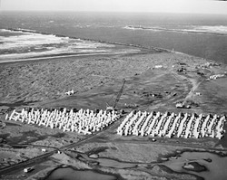 PHOTO COURTESY OF THE U.S. ARMY CORPS OF ENGINEERS - Thousands of dolosse were made in a casting yard on the south spit before being transported to the south and north jetties.