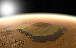 PHOTO FROM NASA - Three times as high as Mount Everest, Mars' Olympus Mons could plausibly have sheltered microscopic life under its warm flanks for billions of years.