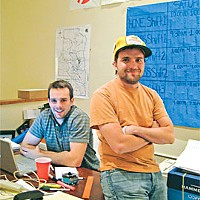Topher Simon, deputy field organizer (standing) and Eric Lowe, out-of-state volunteer. Photo by Judy Hodgson.