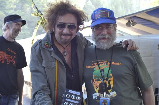 Tree stage MC Jimmy Durchlag hangs out backstage with producer/performer Gaudi, who had traveled from France for this year's Summer Arts and Music Festival in Benbow. - ©TRAVIS TURNER