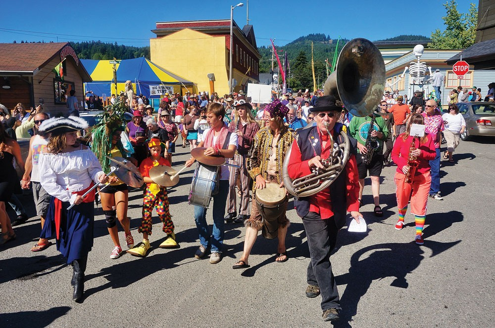 """Tuba player Gregg Moore leads Bandemonium's parade though Blue Lake as the town declares itself """"Center of the Universe"""" on Sunday, June 29. - PHOTO BY BOB DORAN"""