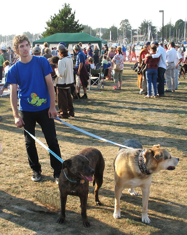 Two dogs and their human at Woofstock - PHOTO BY BOB DORAN