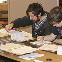 two students go through files at the Humboldt County Department of Environmental Health.