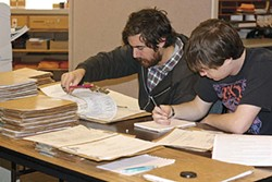 PHOTO BY TORREY HARTMAN - two students go through files at the Humboldt County Department of Environmental Health.