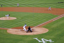PHOTO SPECIAL TO THE JOURNAL - Two-time Giants Cy Young winner Tim Lincecum pitches against the Dodgers in Los Angeles on Sept. 20, while Brett Pill, right, stands ready at first base. Pill also played behind Lincecum during his first season of minor league baseball in Oregon.