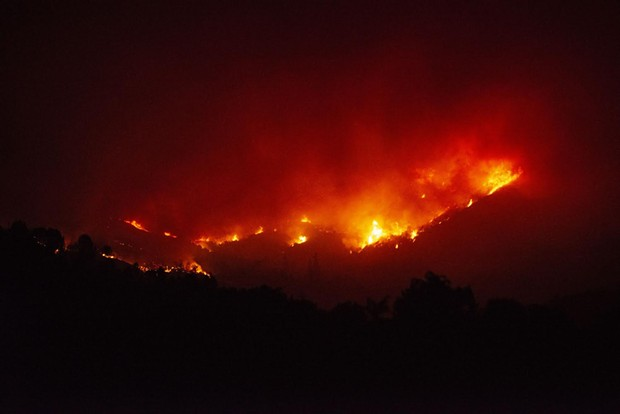 Fire burns the hills north of Upper Lake on Tuesday night. - MARK MCKENNA