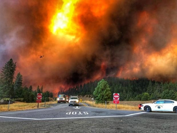 Flames from the Delta Fire near an Interstate 5 exit on Saturday. - INTERAGENCY FIRE MANAGEMENT TEAM