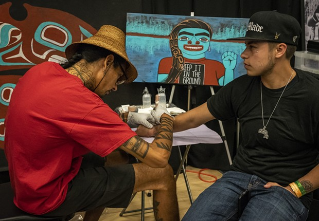 Nahaan (left), of Seattle, focuses on the design style of Northwest Pacific Coast practices, designs and customs of ceremonial tattooing. - PHOTO BY MARK LARSON