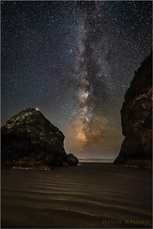 Near the cave's entrance, Mars peeks over the edge as two rocks frame the Milky Way. - DAVID WILSON