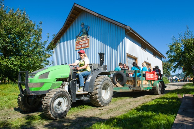 A tractor-pulled hayride through Clendenen's apple orchard. - PHOTO BY MARK MCKENNA