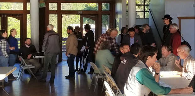 Community members explore their options at the Mateel Community Center this morning. - TARO MURANO/STATE WATER BOARD