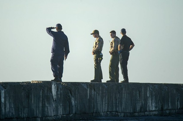 The search for a missing HSU student at the North Jetty on Monday. - MARK MCKENNA