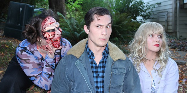 A gory Elizabeth Whittemore with William English III and Shawn Wagner in HSU's Evil Dead: The Musical. - SUBMITTED