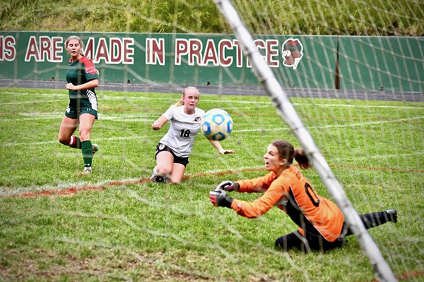 Athena Miller, striker with the Eureka Loggers, watches her kicked ball go into the nets for a goal as Arcata Tiger goalie Sophia Belton stretches out in dismay. - JOSÉ QUEZADA