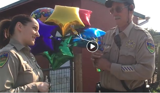 SWAP Farm manager Jeff Dishmon and  Correctional Deputy Samantha Freese in a clip from the video. - HCSO