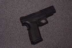 The unregistered .45 caliber handgun a suspect used to shoot a CHP officer with. - EPD