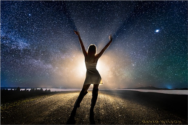 By mid-May, catching the Milky Way's core is no longer an early morning activity. Its position above the horizon a little after 10 p.m.is similar to where it was in February at 5 a.m. This photograph is from somewhere on Monument Road outside of Rio Dell with model Morgan Crowl, May 14, 2018. - DAVID WILSON