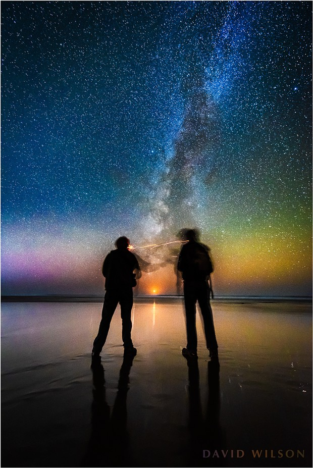 The Milky Way rises from just south of due west as the crescent moon sets between two friends at Moonstone Beach on the evening of November 10, 2018. Two months earlier saw the Milky Way rising from a point that would have been nearer the left edge of the photo in relation to the setting moon. By this time of year the Galactic Core has all but disappeared beneath the horizon. - DAVID WILSON