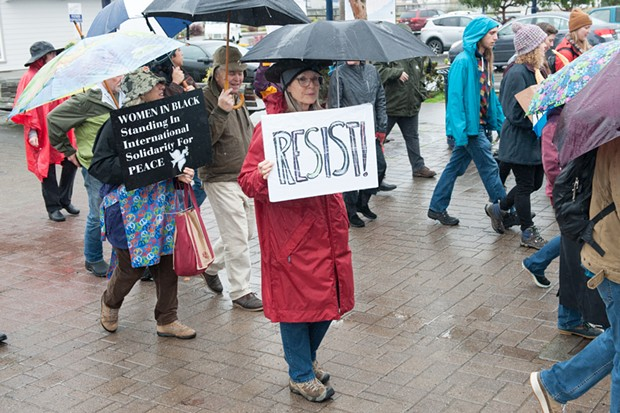 "A marcher with a ""Resist"" sign. - PHOTO BY MARK MCKENNA"