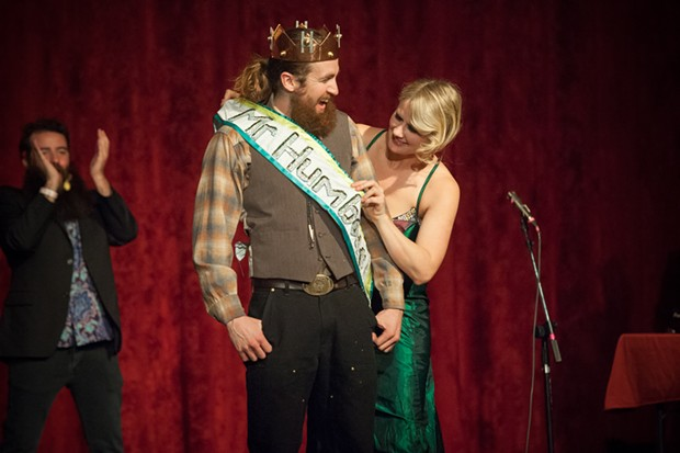 Emcee Johanna Nagan places the sash on Mr. Lumberjack following his crowning as Mr. Humboldt 2019. - PHOTO BY MARK MCKENNA