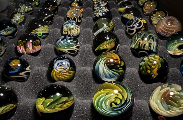 This marble-filled display case attracted onlookers to the artistic creations of Brian Bethea at Bethea Art Glass in Redding, California. - PHOTO BY MARK LARSON