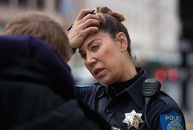 Michelle Lazark, a Sacramento police officer who works in the Mental Health Unit, put Jeffrey Jurgens back in touch with his mother. - PHOTO BY RANDY PENCH FOR CALMATTERS