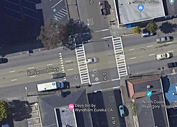 """The intersection of D and Fifth streets. Under a new proposal, the crosswalk on the north side of the intersection — the """"downstream side"""" — would be eliminated. - GOOGLE MAPS"""