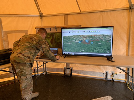 National Guard Staff Sgt. Alan Clark out of Sacramento uses the Nano computer, which uses satellite technology to track search and rescue crews looking for the Carrico sisters. - MARK MCKENNA