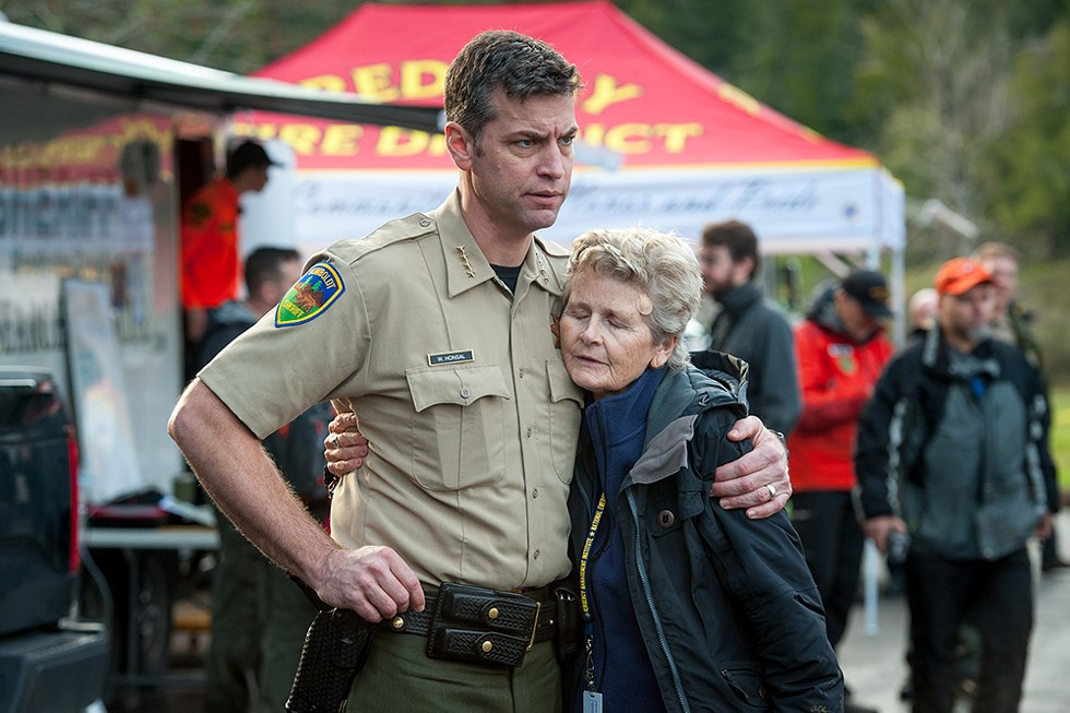 Humboldt County Sheriff William Honsal hugs Supervisor Estelle Fennell shortly before search teams held a debriefing at the command post on Saturday evening. - PHOTO BY MARK MCKENNA