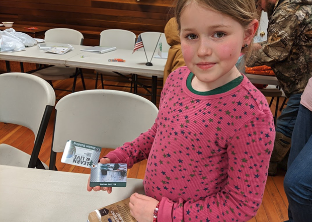 Leia Carrico, one of the two sisters who were lost last weekend, holds a set of flashcards with shelter building advice given to her by her instructor, Jason Lehnert. - MARK MCKENNA
