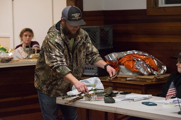 Justin Lehnert pointed out how anyone lost in the wilderness without specialized gear could still help searchers by using sticks to make an arrow to show their direction of travel. - MARK MCKENNA