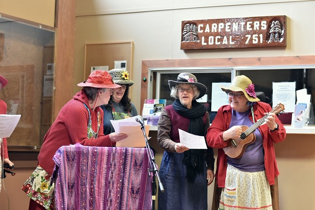 The Raging Grannies lead a sing-along with the crowd. - PHOTO BY MEGAN BENDER