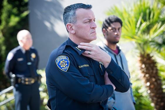 HSU University Police Chief Donn Peterson listens while Charmaine Lawson speaks of her son. - MARK MCKENNA