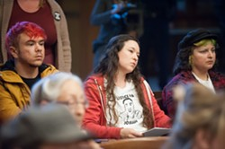 Kelsey Reedy, center, an HSU alum and community member, listens to speakers asking the Arcata City Council to call for outside help in the Josiah Lawson homicide investigation. - MARK MCKENNA