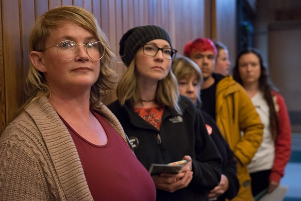 Jill Larrabee, left, waits to speak at the Arcata City Council meeting regarding the Josiah Lawson case and joined others in calling on city officials to call the DOJ or another outside agency to assist the investigation. - MARK MCKENNA
