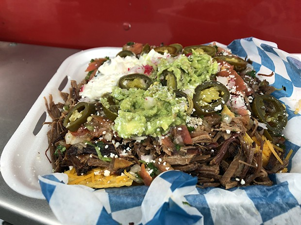 Brisket nachos for the hungry or social. - PHOTO BY JENNIFER FUMIKO CAHILL
