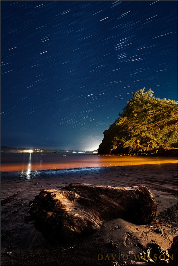 The stars arc across the sky in their nightly parade in this view looking south from Boat Launch Beach, or Indian Beach, beneath the town of Trinidad, California. January 30, 2019. - DAVID WILSON