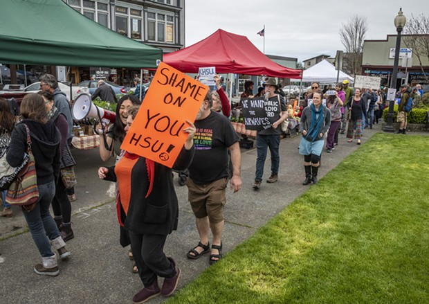 Demonstrators unhappy with the firing of KHSU staffers and the suspension of local programming gathered into a protest walk around the farmers market area. - PHOTO BY MARK LARSON
