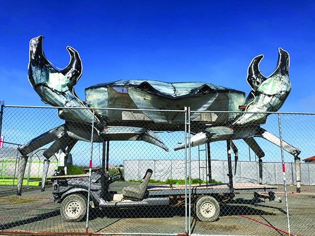 Dan McCauley's shining metal crab awakens from its post-Burning Man slumber and raises its pincers in the lot of Spaulding Construction off U.S. Highway 101 in Eureka. - PHOTO BY JENNIFER FUMIKO CAHILL