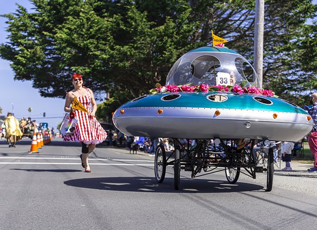 A flying saucer festooned with rhododendrons for the parade. - PHOTO BY SAM LEISHMAN