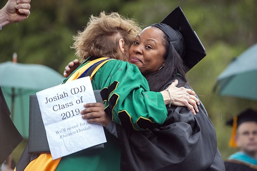 HSU President Lisa Rossbacher and Charmaine Lawson embrace after Lawson accepted an honorary degree on behalf of her son, David Josiah Lawson. - MARK MCKENNA