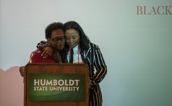 Lorna Bryant and Charmaine Lawson embrace at Black Heritage Graduation Celebration. - IRIDIAN CASAREZ