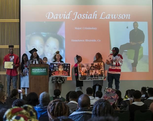 Charmaine Lawson and her family accept David Josiah Lawson's roses at Black Heritage Graduation Celebration. - IRIDIAN CASAREZ